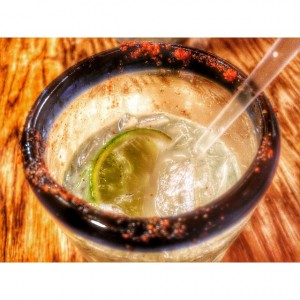 A margarita on the rocks with chile on the rim